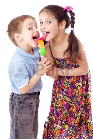 13708688-girl-and-boy-licking-ice-cream-together-isolated-on-white
